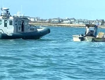 Massachusetts Environmental Police escort a fishing vessel owned and operated by a 73-year old Taunton man back to Scituate Harbor after the man was observed setting lobster traps in an area prohibited by the state.