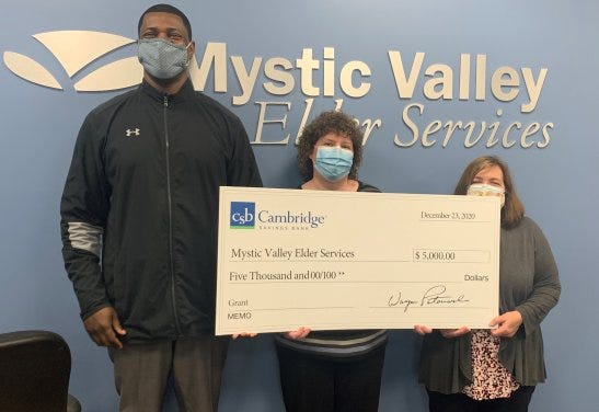 Cambridge Savings Bank AVP, Small Business Development Officer Olritch Donnat presents a $5,000 check to Mystic Valley Elder Services Nutrition Director Angie Fitzgerald and Nutrition Program Manager Linda Crowe.