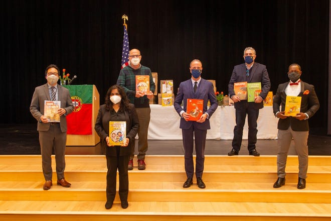 The Consul General of Portugal in Boston Joao Pedro Fins de Lago made a donation of Portugese language resources to the Olá program at the King Open Elementary School. Pictured are Superintendent Kenneth Salim, Mayor Sumbul Siddiqui, School Committee member Fred Fantini, Consul Joao Pedro Fins do Lago, Coordinator for the Portuguese Language and Education Affairs Joao Caixinha and King Open Principal Darrell Williams.