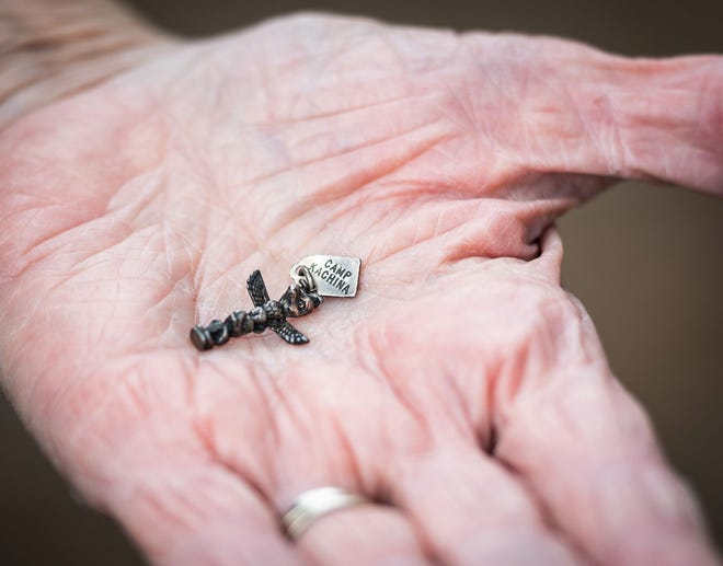 """The Korean War memento Maureen Burdulis found, which is in the form of a totem pole and on the tag depicts the word """"Camp Kachina."""""""