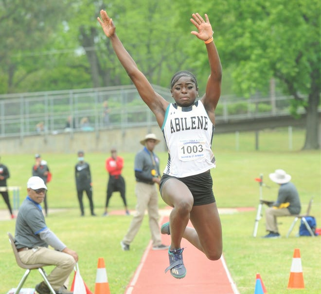 Abilene High's Perside Ebengo competes in the triple jump at the Region I-6A track and field meet Friday at Maverick Stadium in Arlington. She won the event with a 39-7.