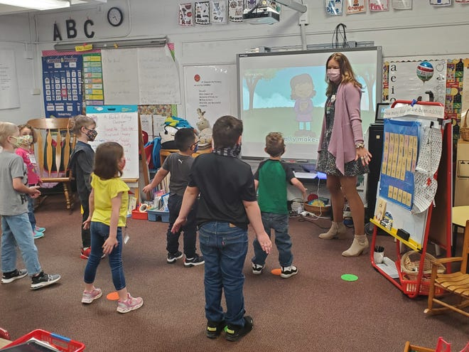 Buncombe County district Teacher of the Year Jennifer Shelley teaches her kindergartners at Weaverville Primary School in-person after months of virtual instruction.