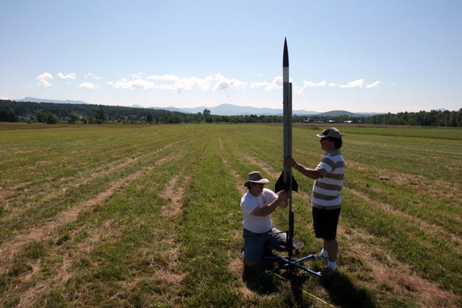 Howie Druckerman (left) of Essex Junction works with Randy Whitcomb of South Burlington, to set up Druckerman's rocket moments before its launch on July 22, 2007. The two were part of a group of about a dozen people gathered in Essex Junction this past Sunday morning; some there to watch, and others part of the Champlain Region Model Rocket Club.