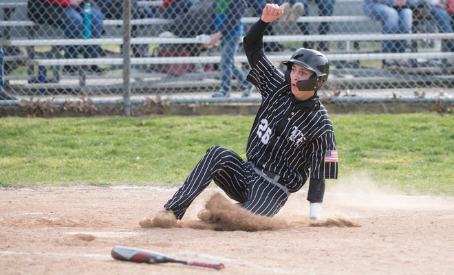 Bishop Eustace's Dan Obermeier scores after being batted in by Bishop Eustace's Ian Petrutz during Bishop Eustace's 2-0 victory over Ocean City in Somers Point on Friday, April 23, 2021.