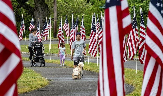 Rebecca Rodriguez of Medford, is joined by her daugher Madison, 3, and son Chase, 11, as they walk along the Burlington County Field of Honor at Freedom Park in Medford on Saturday, May 23, 2020.