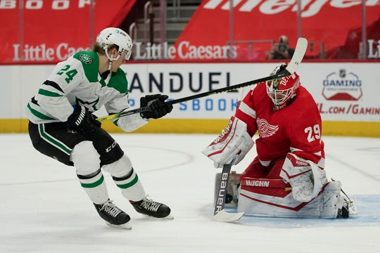 Detroit Red Wings goalkeeper Thomas Greiss (29) halts Dallas Stars' Esa Lindell (23) shot during the first part of an NHL hockey game on Thursday, April 22, 2021 in Detroit.