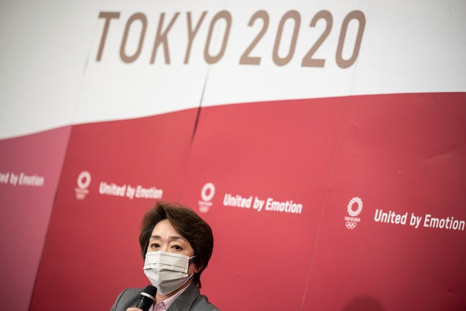 Seiko Hashimoto, president of Tokyo 2020 attends a media huddle following the IOC Executive Board Meeting at the Tokyo 2020 headquarters in Tokyo, Wednesday, April 21, 2021.