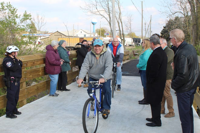 Ottawa County Commissioners Donald Douglas and Mark Coppeler started their bike rides from Elmore to Genoa Thursday on the North Coast Inland Bike Trail. Ottawa County officials and mayors from both villages held a dedication ceremony for the trail extension between Elmore and Genoa.