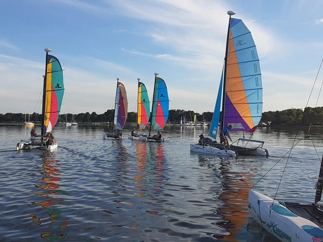 Project OWEN: International Youth Sailing of Oshkosh was awarded a seed grant from The Canary Fund to help purchase new life jackets for both student and adult sailors.