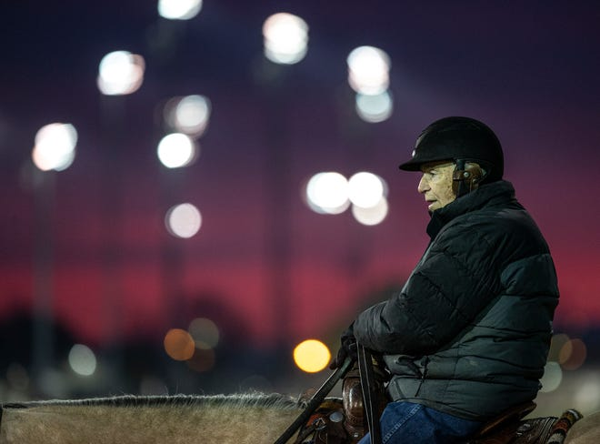 Legendary trainer D. Wayne Lukas watches his horses train from the side of the track at Churchill Downs. April 23, 2021