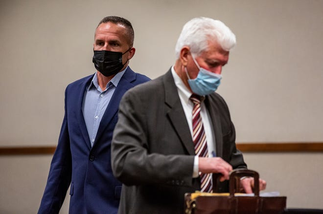 Former Louisville Metro Police detective Brett Hankison, left, arrives in the courtroom with his attorney Stew Mathews for a pre-trial conference on Friday, where Circuit Judge Ann Bailey Smith moved Hankison's trial to Feb. 1, 2022. April 23, 2021