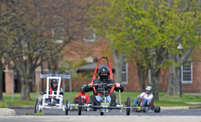 Racers speed around the parking lot in their battery powered vehicles as they compete Friday afternoon during the Kehoe Grand Prix at the Kehoe Center in Shelby.