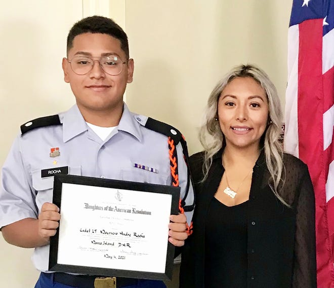 Lely High School sophomore, Mauricio A Rocha of Marco Island, with his mother, Lizbeth Palacios, displaying his DAR outstanding JROTC cadet certificate.
