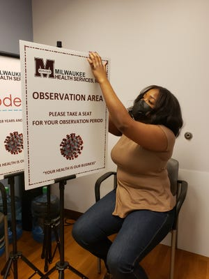 Erica Crigler, nurse manager at Milwaukee Health Services, helps prepare for the community health center's first walk-in vaccination clinic set for Saturday.