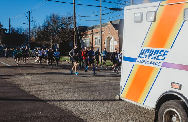Runners chase an ambulance in February 2020 as part of a Montgomery County Bar Association charity run. The 2021 event will be held on May 8.