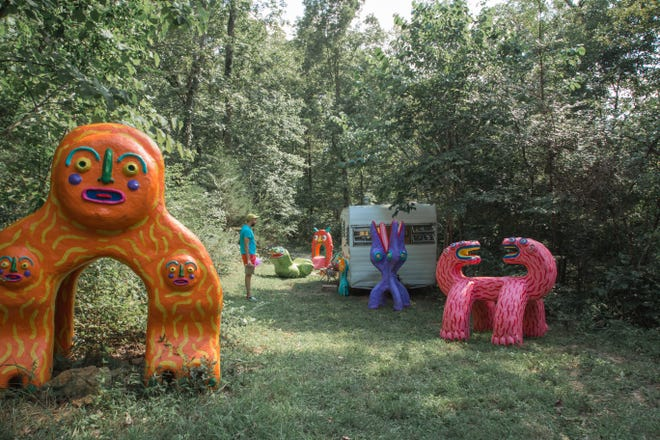 Artist Brett Hunter stands among the 'creatures' he co-created with partner Rebecca Blevins at Creature Camp near Nashville, TN.
