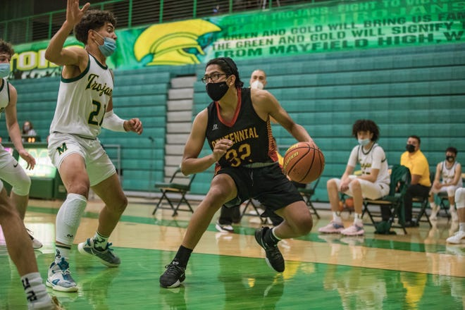 Jesus Luna-alvarado (32) works past a defender as the Mayfield Trojans face off against the Centennial Hawks at Mayfield High School in Las Cruces on Thursday, April 22, 2021.