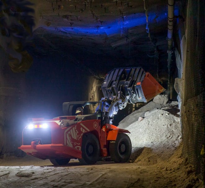 A battery powered load-haul-dump loader moves mined salt in the Waste Isolation Pilot Plant underground.