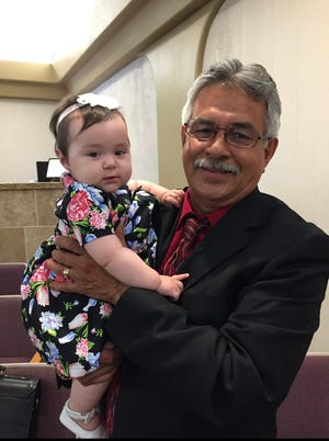 Franciso Javier Rendon Sr. photographed with one of his grandchildren. He died of complications related to COVID-19 on Dec. 26, 2020, after, his family believes, he contracted the illness while working for SunLine Transit Agency.