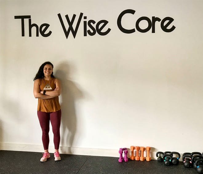 Gigi Verstegen, owner of The Wise Core fitness studio in St. Clair's Riverview Plaza, poses for a photo inside the studio on April 22, 2021.