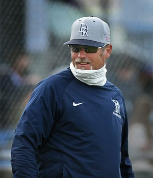 Damonte Ranch baseball coach Jon Polson talks with staff at the start of a game against Reno on April 22, 2021.