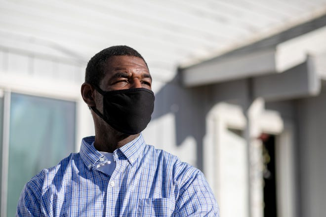 "Stacy Estes in front of the home he shares with his fiancée in Sacramento, Calif on Wednesday, April 7, 2021. ""I don't mind paying what it takes to raise my kids,"" Estes said, but having his wages garnished for nearly 25 years has placed an unsustainable financial burden on him."