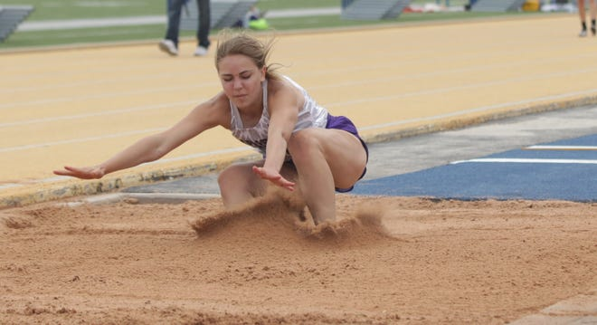 Irion County High School's Audrey Tillman lands in the pit during the girls long jump competition in the Region II-1A Track and Field Championships Friday, April 23, 2021, at LeGrand Stadium at Angelo State University.