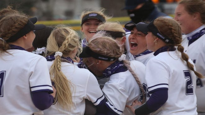 USF players celebrate their first-ever win against a No. 1 ranked team Thursday against Augustana at Sherman Park