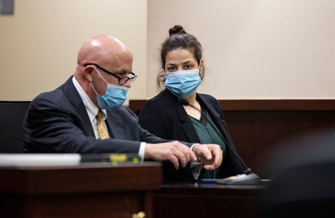 Nikoleta Koikos, 37, right, talks with her defense attorney David Collins after hearing questions the jury had while deliberating. Koikos was on trial, charged with vehicular homicide and DUI manslaughter in connection with the death of Gary Diskerud.