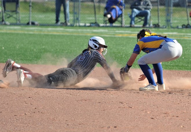 John Glenn's Hannah Bendle dives back into first base in during a game with Maysville. Bendle was voted to the Division II All-Ohio first team after leading the Muskies to a state final four berth.