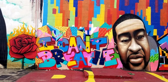 A mural of George Floyd by artist Daniel Anguilu and others in Houston's Graffiti Park.