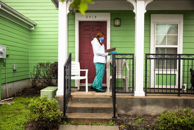 Nurse practitioner Sophia Thomas goes door-to-door administering COVID-19 vaccines in New Orleans on Saturday, April 17, 2021.