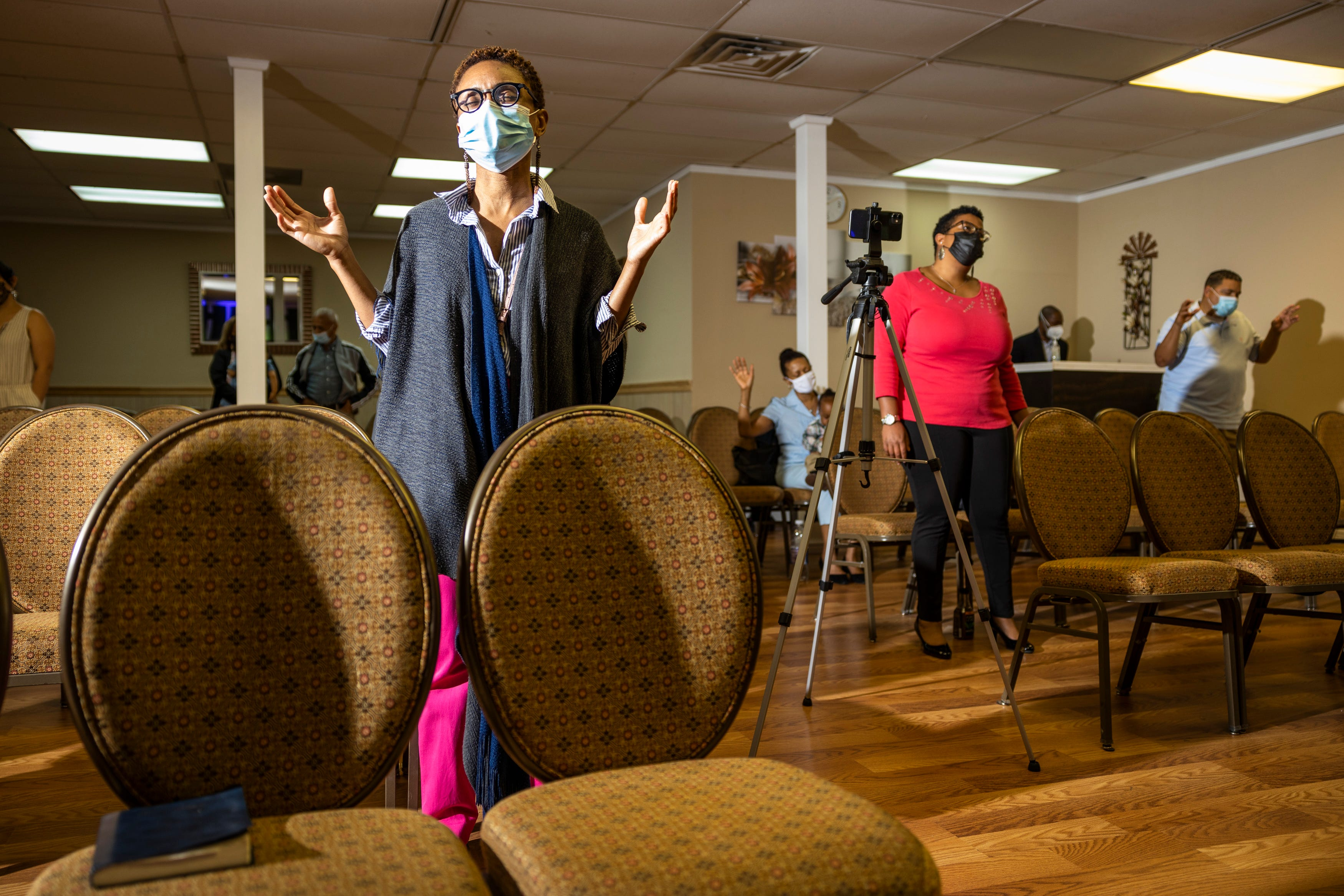 Kertrina Watson Lewis, 43, worships at Impact Ministries of New Orleans , her first time attending an in-person church service since the beginning of the pandemic on Sunday, April 18, 2021. The pastor of the church, Dr. Stacy Greene, is an infectious disease specialist.