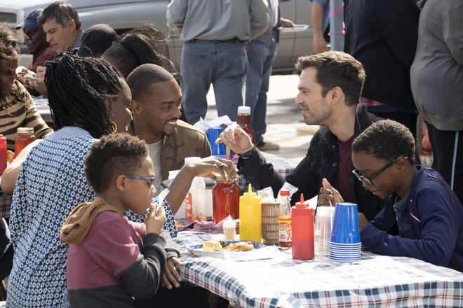 "Sam (Anthony Mackie) and Bucky (Sebastian Stan) share a meal in Sam's hometown at the end of ""The Falcon and the Winter Soldier."""