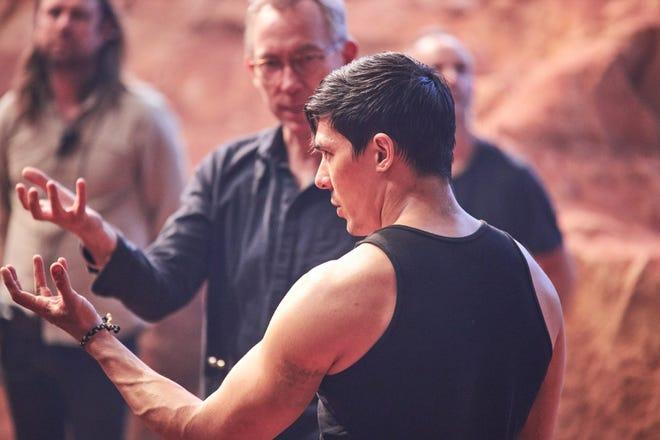 "Director  Simon McQuoid with Lewis Tan on ""Mortal Kombat."""