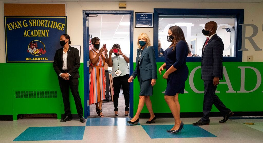 Teachers take photos from their classroom as Jill Biden, the wife of Democratic presidential candidate Joe Biden, tours Shortlidge Academy in Wilmington, Delaware, on September 1, 2020 with Principal Deborah Ashton (2nd R) and Superintendent Dorrell Green (R). (Photo by JIM WATSON / AFP) (Photo by JIM WATSON/AFP via Getty Images)