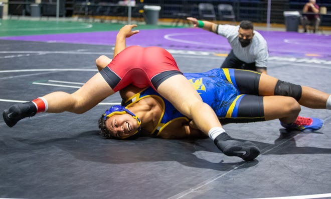 Anderson's Kelby Hickerson, bottom, gets pinned in the 220-pound title match against Carrollton Creekview's Mason Ding at the UIL Class 5A state wrestling tournament Friday at the Berry Center in Cypress.
