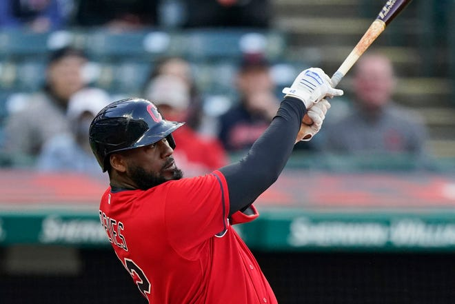 Cleveland's Franmil Reyes watches his one-run double in the first inning of a baseball game against the New York Yankees, Friday, April 23, 2021, in Cleveland. [Tony Dejak/Associated Press]