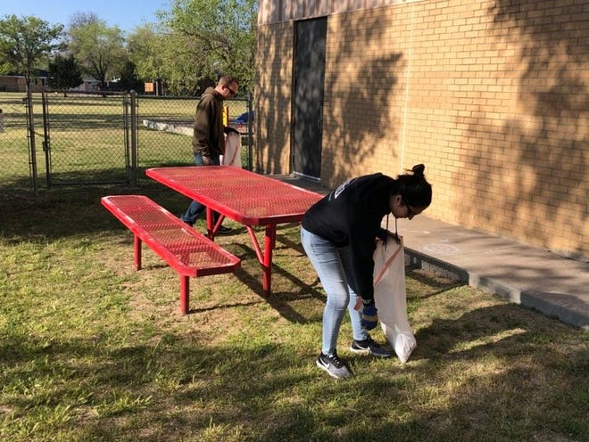 Members of the community participate in Saturday's community-wide cleanup at Bivins Elementary.
