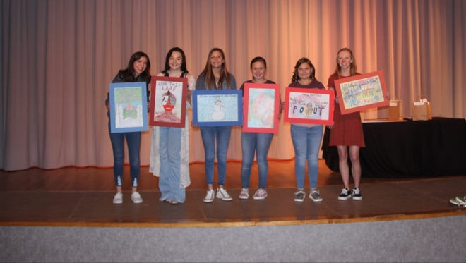 The winners of the Carter County Litter Poster Contest show off their creations after an awards ceremony hosted by the Ardmore Beautification Council on Thursday, April 22. Over 200 students from seven local schools participated in the contest which was divided into three age categories. A first, second and third place winner was selected from each category.