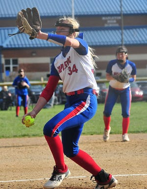 Mapleton's Roxie Hamilton lets loose a pitch against New London during the Mounties' 6-1 win Friday at Mapleton High School.