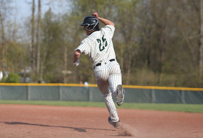 Riverside's Aaron Falk (25) celebrates as he's rounding first after hitting a home run during the fifth inning against Ellwood City at Riverside High School.