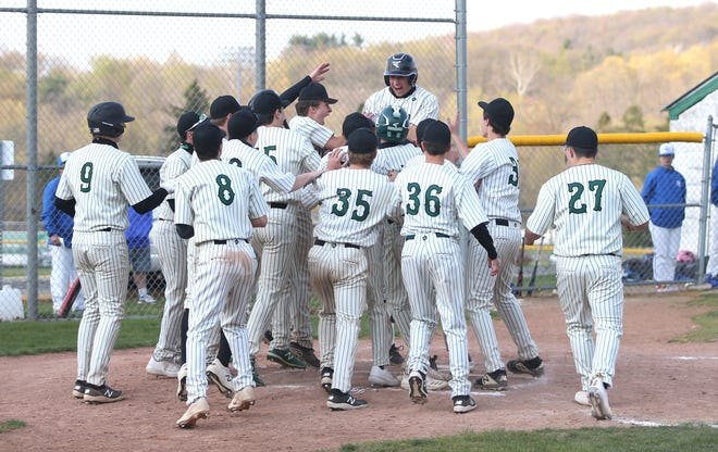 Riverside's Aaron Falk (25) celebrates with his teammates at home plate after hitting a home run during the fifth inning against Ellwood City Friday evening at Riverside High School.
