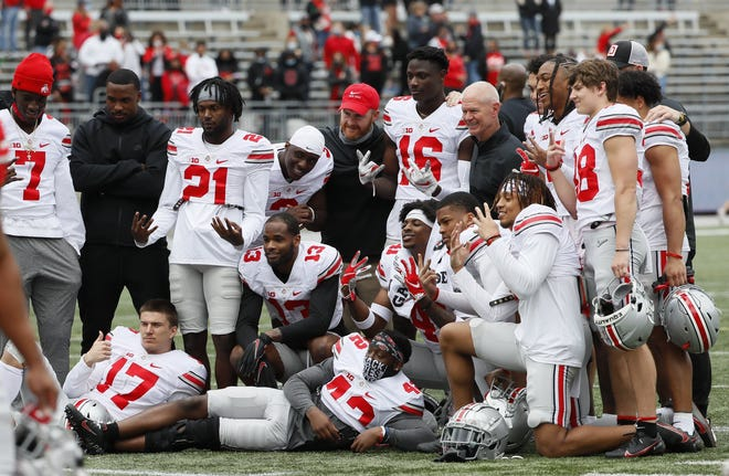 Defensive coordinator Kerry Coombs, standing at right after the spring game on April 17, is happy with the depth in the Buckeyes' secondary.