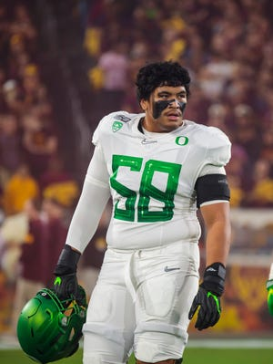 Oregon tackle Penei Sewell sat out the 2020 season because of COVID-19 concerns but is expected to be the first offensive lineman drafted on Thursday.