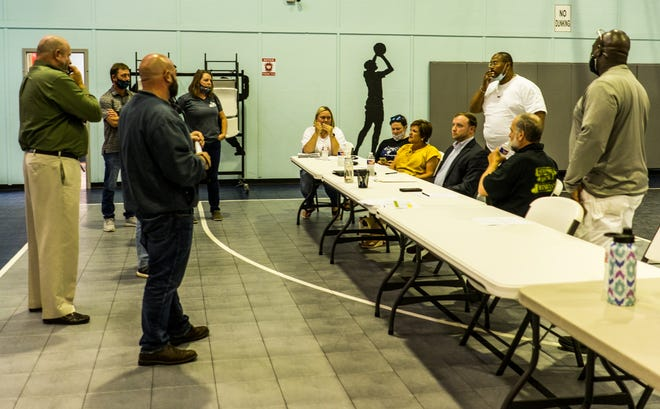 Residents and members of the Rec District Board 1 and Terrebonne's recreation task force discuss a proposed bond sale for a new park Friday at the Oakshire Gym.