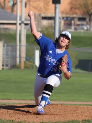 Cambridge sophomore Andy Ogle (16) delivers a pitch during Friday's game with visiting Minerva High at Don Coss Stadium.