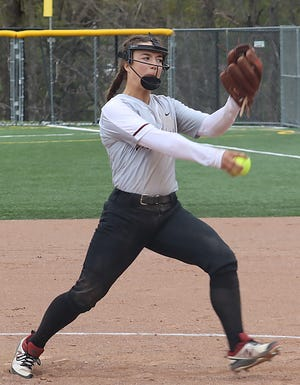 John Glenn sophomore Hannah Bendle (12) lets fly with a pitch during Saturday's doubleheader with St. Clairsville at John Glenn High School. The Lady Muskies improved to a perfect 21-0 with a sweep by scores of 17-7 and 12-1.