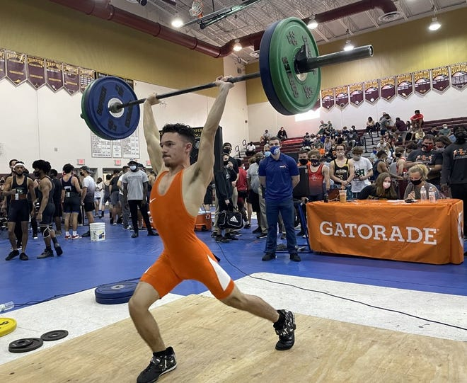 Justin Irizarry became University's first state weightlifting champion Saturday, hitting a personal-best 215-pound clean and jerk.