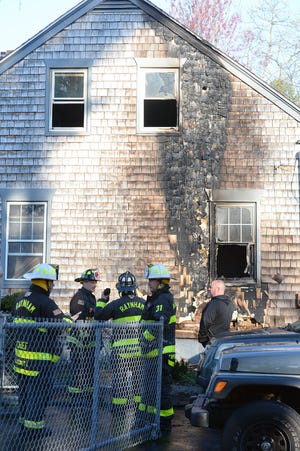 Raynham firefighters battled a house fire at 349 Hill St., Saturday, April 24, 2021.